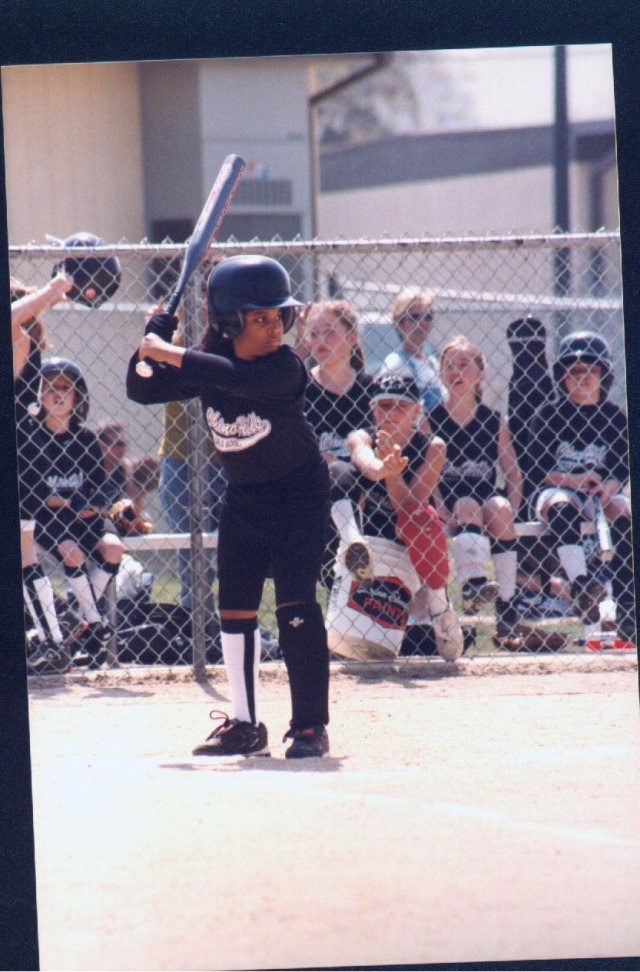 My daughter playing softball at eight years old
