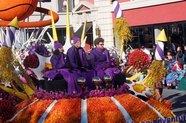 Lakers legion Kareem Abdul-Jabbar rides on the Los Angeles Lakers float.
